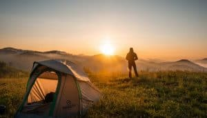 man watching sunset with tent