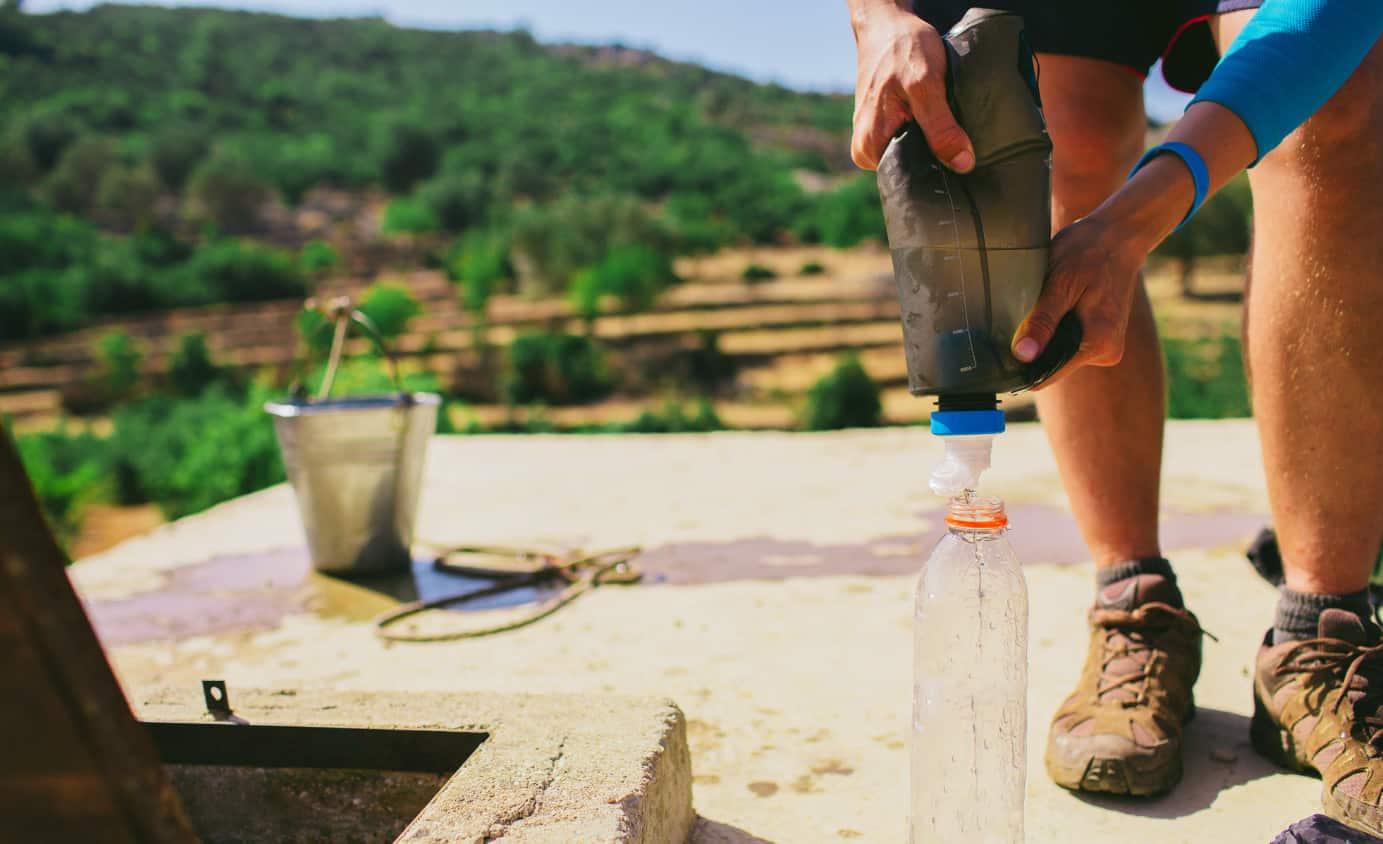 man filters water